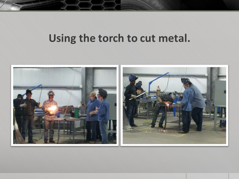 Using the torch to cut metal.