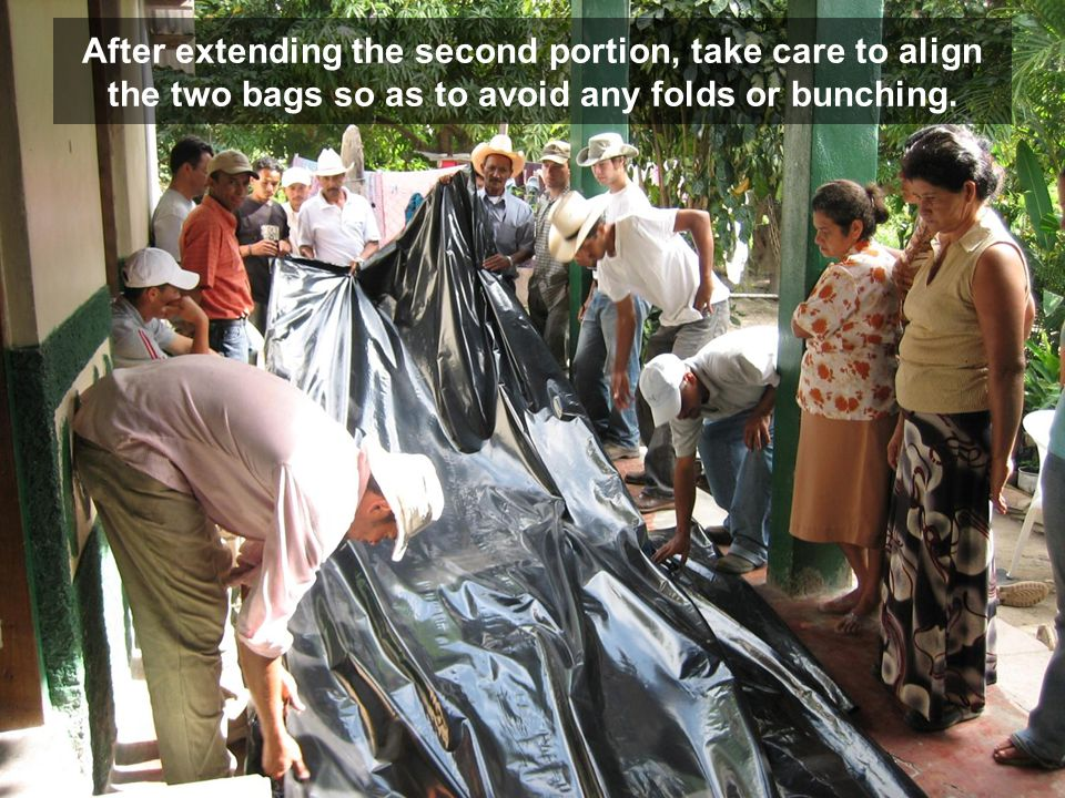 After extending the second portion, take care to align the two bags so as to avoid any folds or bunching.