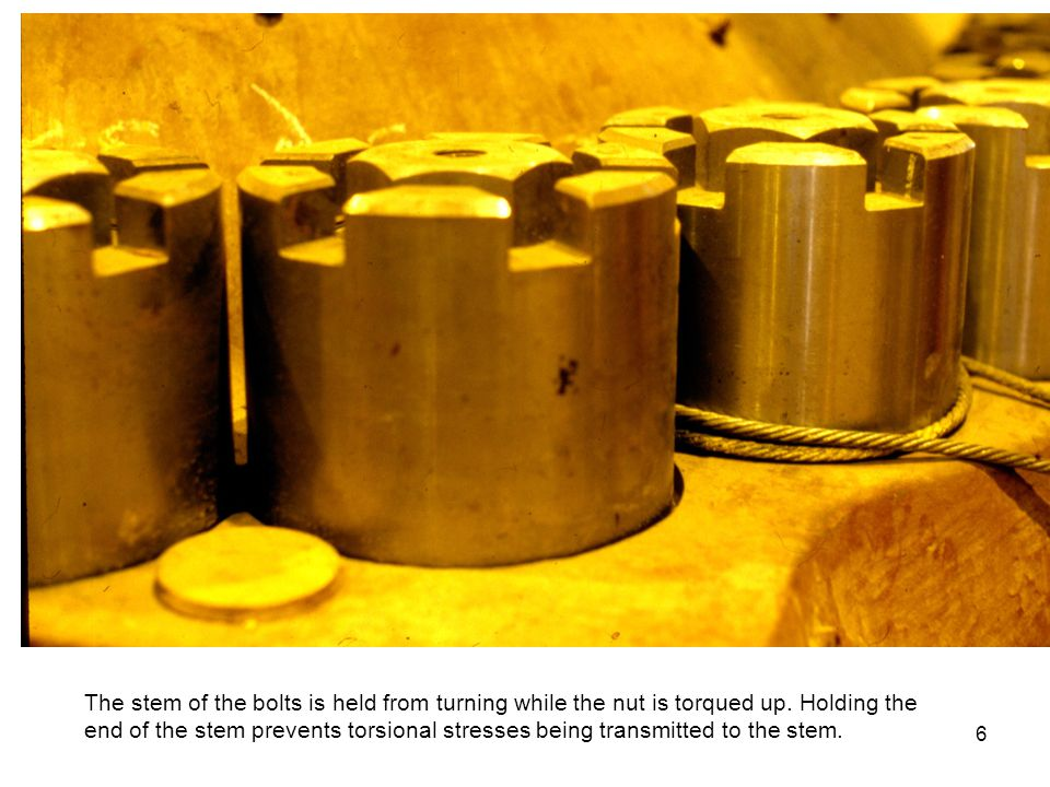 The stem of the bolts is held from turning while the nut is torqued up.