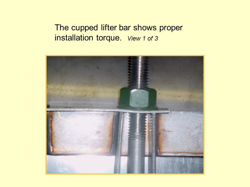 The cupped lifter bar shows proper installation torque. View 1 of 3
