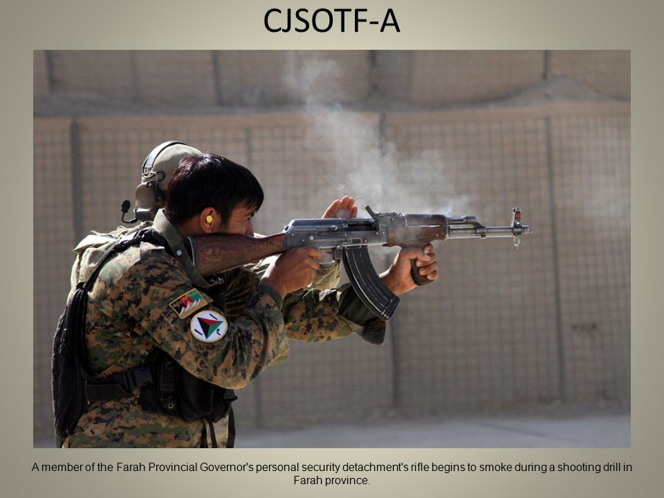 CJSOTF-A A member of the Farah Provincial Governor s personal security detachment s rifle begins to smoke during a shooting drill in Farah province.