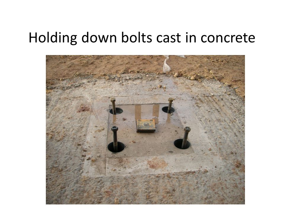 Holding down bolts cast in concrete