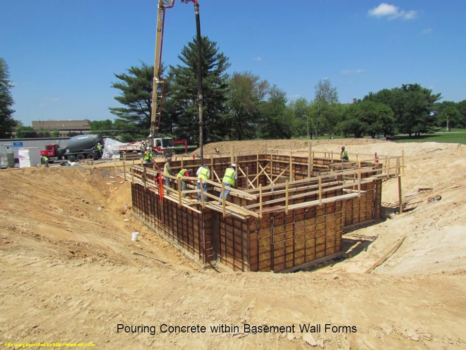 NZERTF Gaithersburg, MD 31 Basement Walls Complete, Waterproofing Complete, Floor Trusses in Place Pouring Concrete within Basement Wall Forms File copy provided by http://www.wll.com