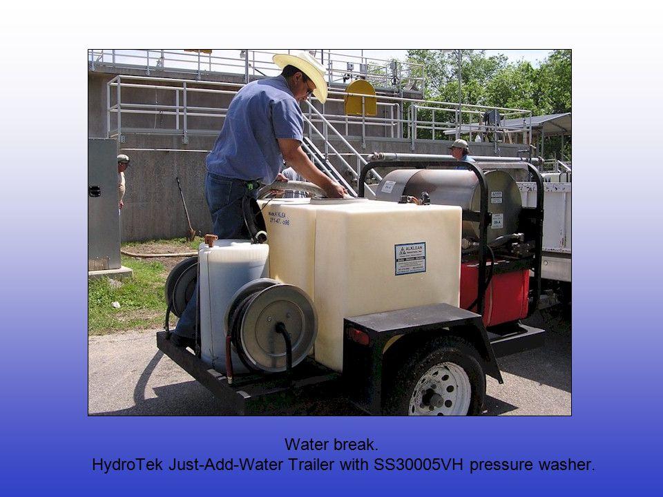 Water break. HydroTek Just-Add-Water Trailer with SS30005VH pressure washer.