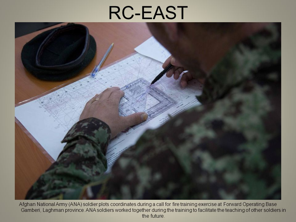 RC-EAST Afghan National Army (ANA) soldier plots coordinates during a call for fire training exercise at Forward Operating Base Gamberi, Laghman province.