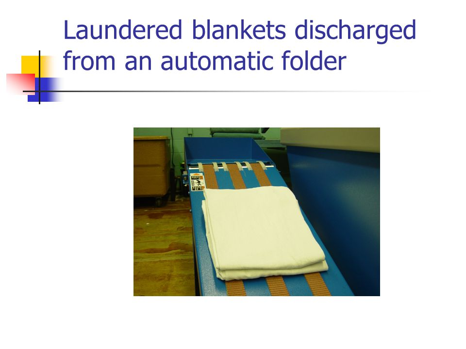 Laundered blankets discharged from an automatic folder