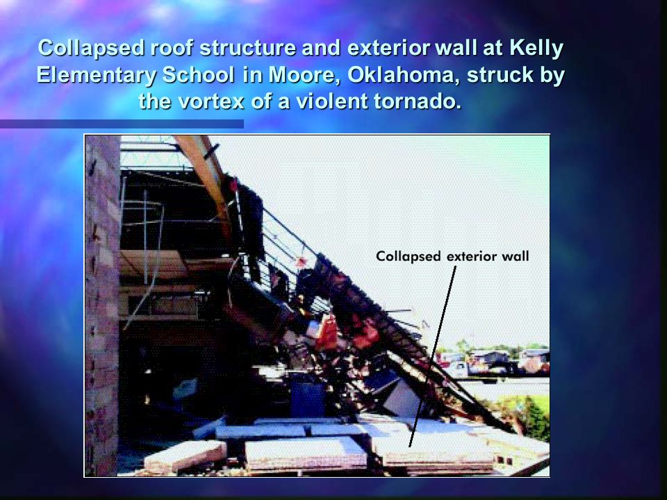 Collapsed roof structure and exterior wall at Kelly Elementary School in Moore, Oklahoma, struck by the vortex of a violent tornado.