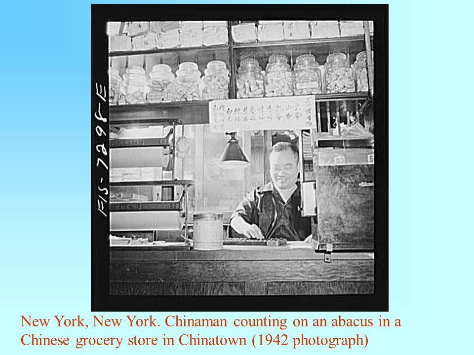 New York, New York. Chinaman counting on an abacus in a Chinese grocery store in Chinatown (1942 photograph)
