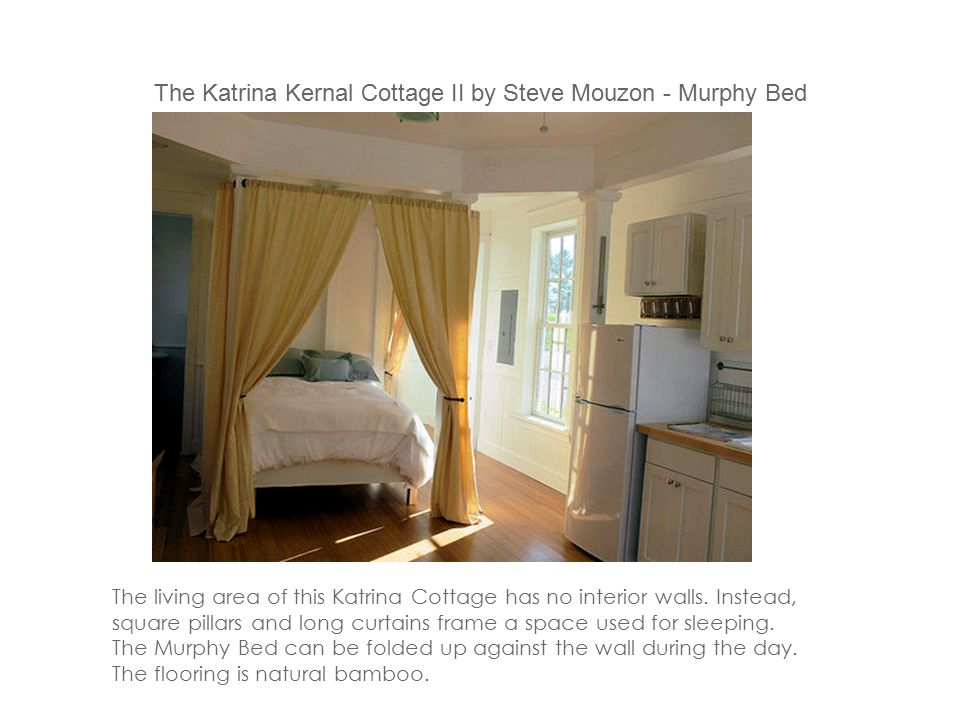 The living area of this Katrina Cottage has no interior walls. Instead, square pillars and long curtains frame a space used for sleeping. The Murphy B