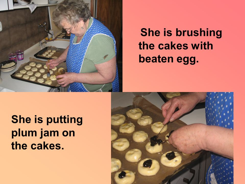 She is brushing the cakes with beaten egg. She is putting plum jam on the cakes.