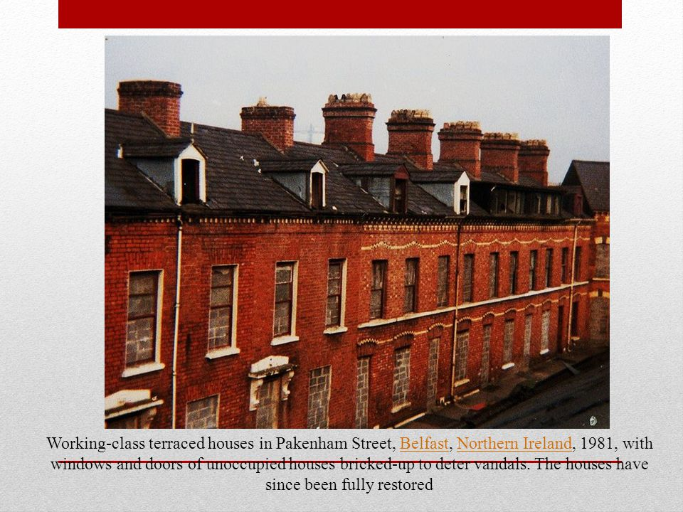 Working-class terraced houses in Pakenham Street, Belfast, Northern Ireland, 1981, with windows and doors of unoccupied houses bricked-up to deter vandals.
