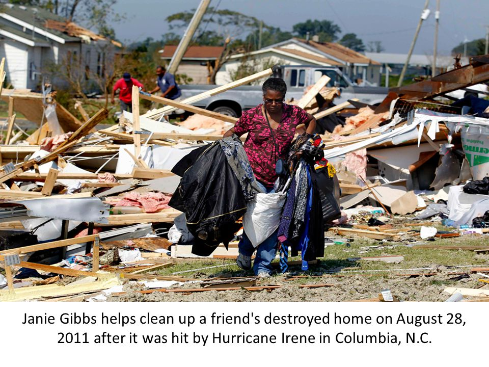 Janie Gibbs helps clean up a friend s destroyed home on August 28, 2011 after it was hit by Hurricane Irene in Columbia, N.C.