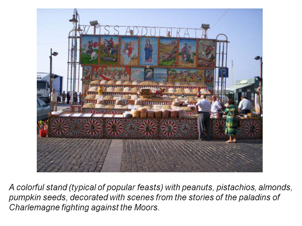 A colorful stand (typical of popular feasts) with peanuts, pistachios, almonds, pumpkin seeds, decorated with scenes from the stories of the paladins of Charlemagne fighting against the Moors.