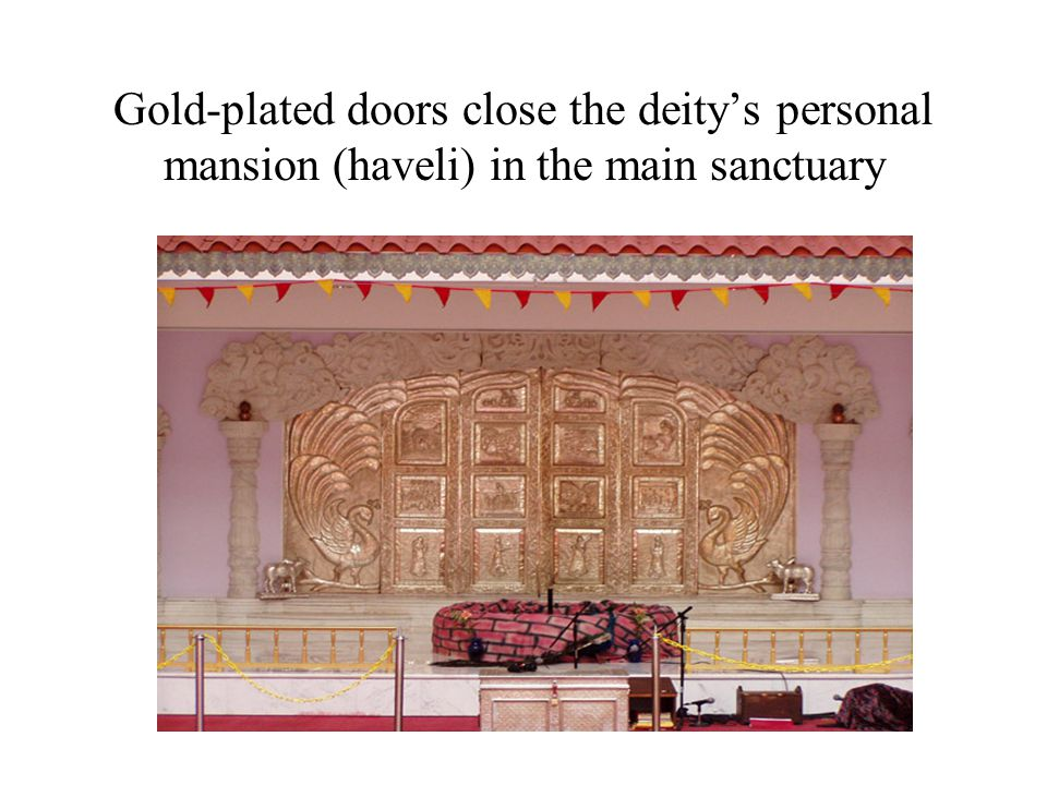 Gold-plated doors close the deity's personal mansion (haveli) in the main sanctuary