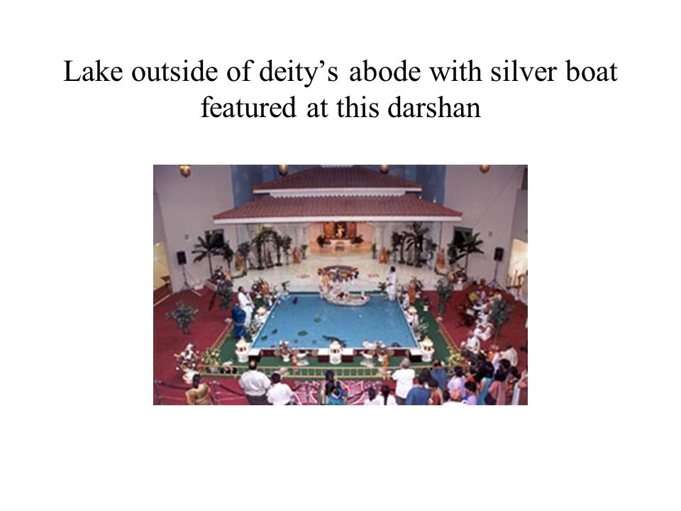 Lake outside of deity's abode with silver boat featured at this darshan