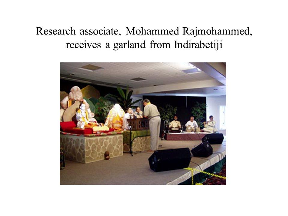 Research associate, Mohammed Rajmohammed, receives a garland from Indirabetiji