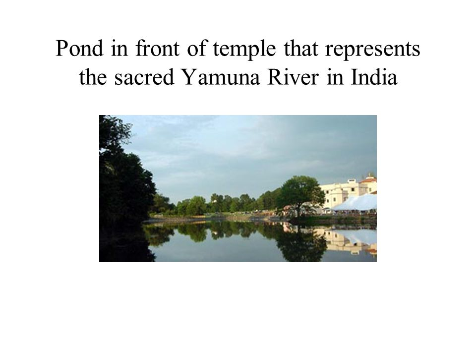 Pond in front of temple that represents the sacred Yamuna River in India