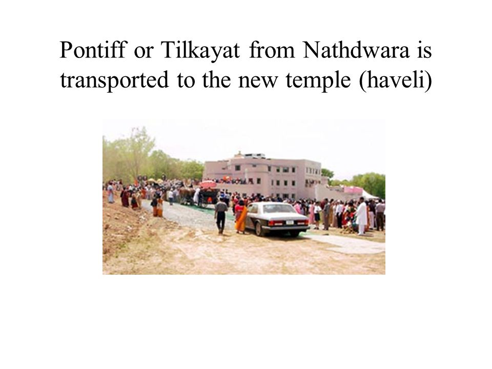 Procession during dedication moves towards the temple