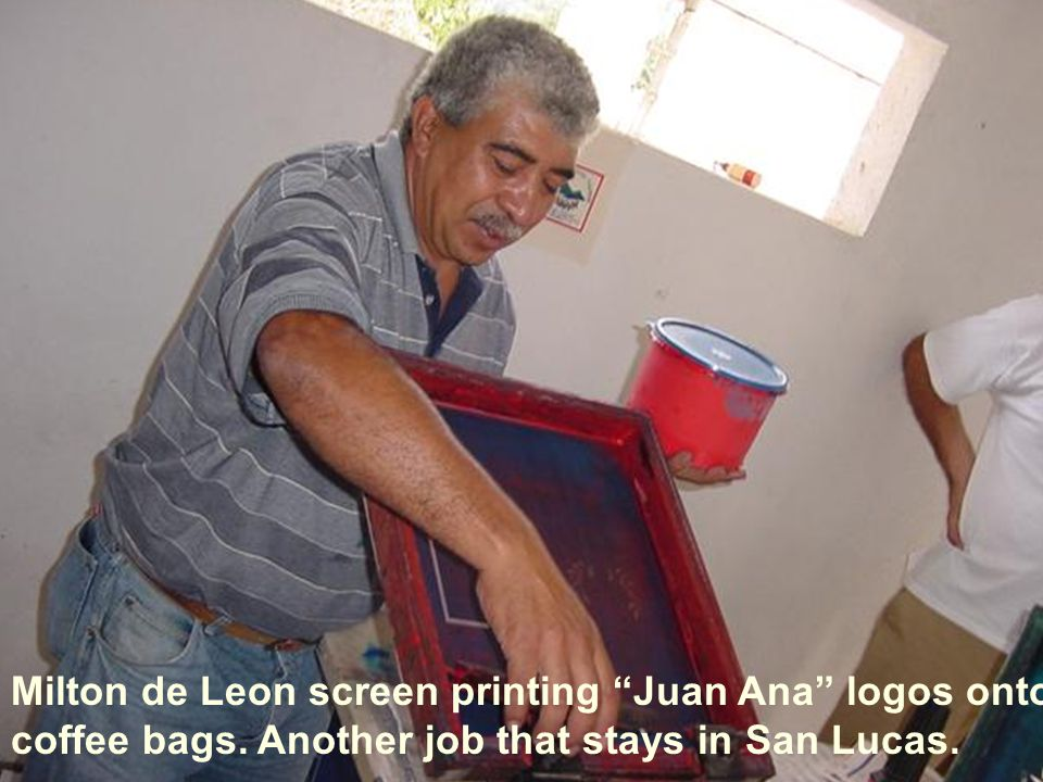 Milton de Leon screen printing Juan Ana logos onto coffee bags.