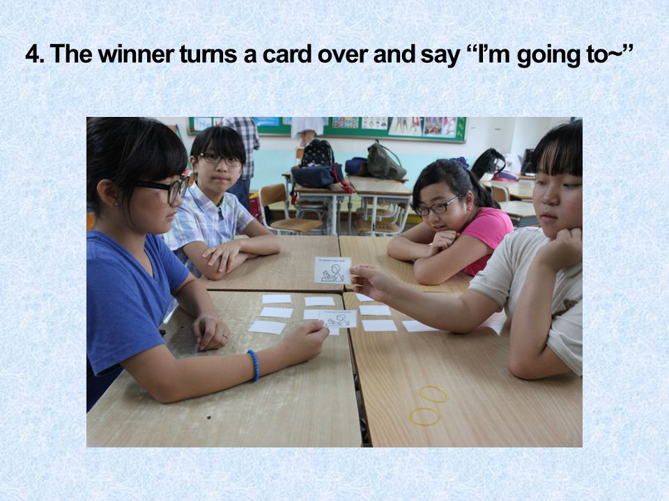 4. The winner turns a card over and say I'm going to~