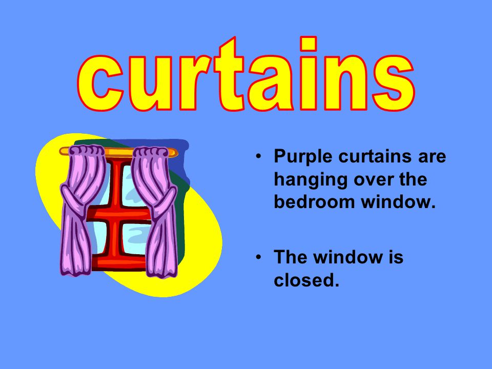 Purple curtains are hanging over the bedroom window. The window is closed.