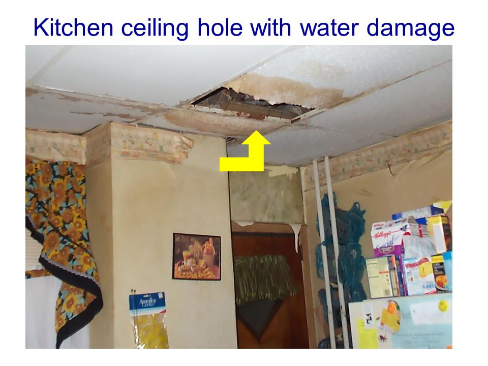Kitchen ceiling hole with water damage