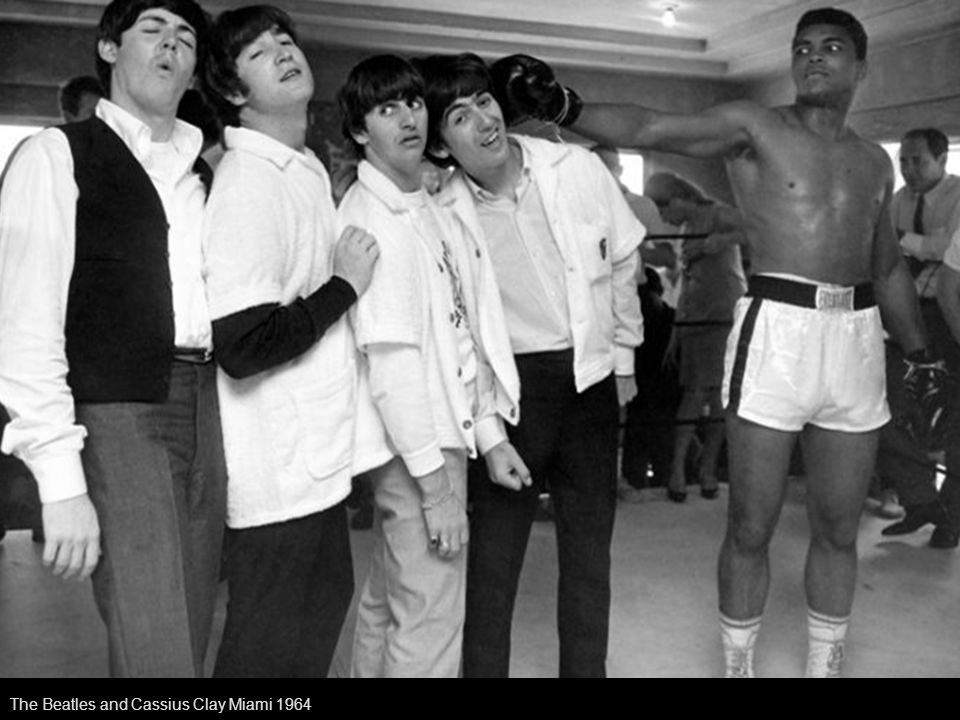 Ed Sullivan, center, stands with The Beatles during a rehearsal for the British group s first American appearance, on the Ed Sullivan Show, in New York on Feb.
