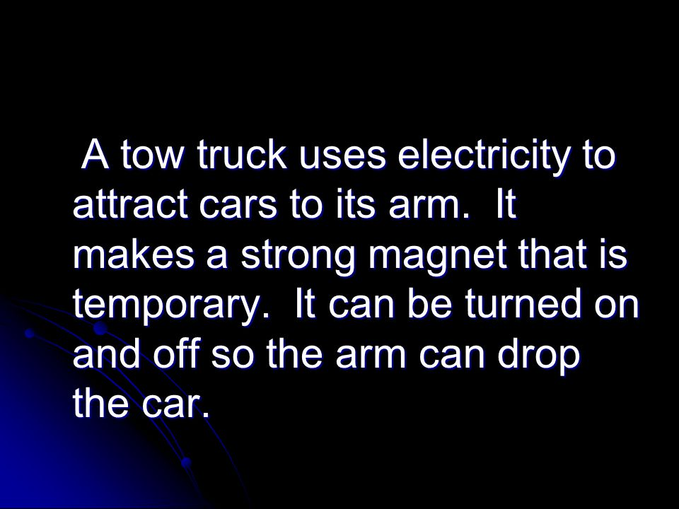 A tow truck uses electricity to attract cars to its arm.