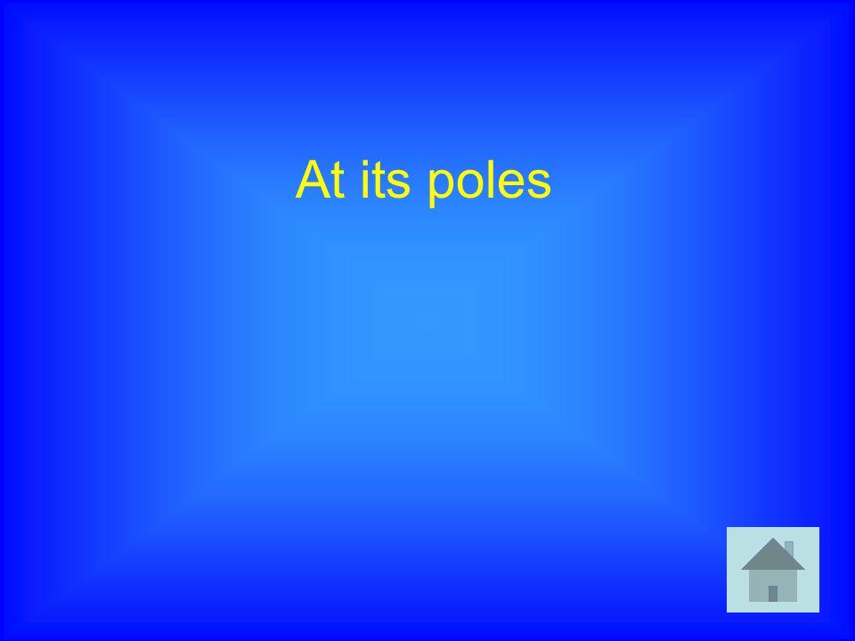 At its poles