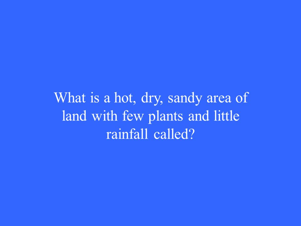 What is a hot, dry, sandy area of land with few plants and little rainfall called