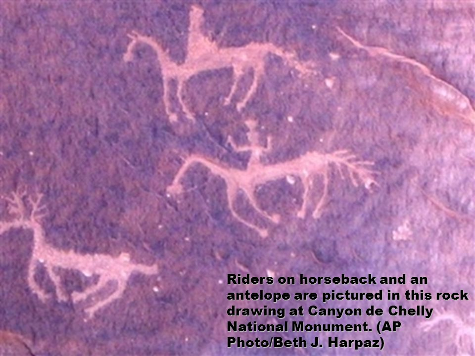 Riders on horseback and an antelope are pictured in this rock drawing at Canyon de Chelly National Monument. (AP Photo/Beth J. Harpaz)