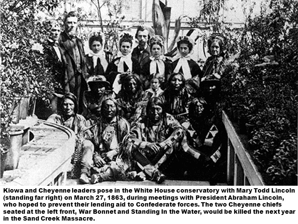 Kiowa and Cheyenne leaders pose in the White House conservatory with Mary Todd Lincoln (standing far right) on March 27, 1863, during meetings with Pr