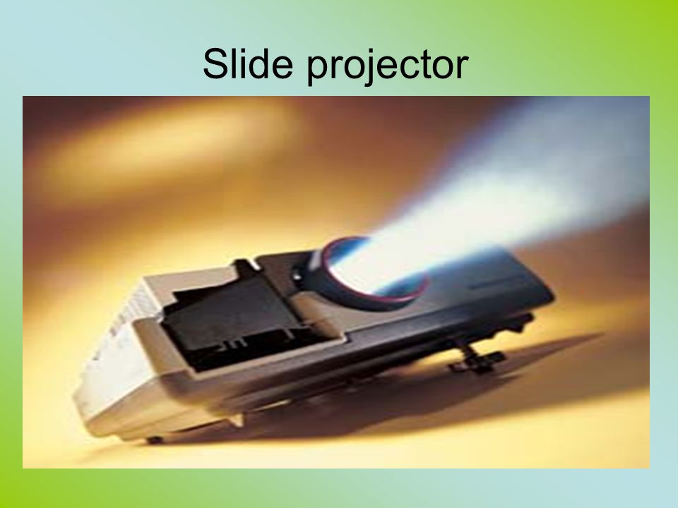Slide Projector components a fan-cooled electric light bulb a reflector and condensing lens to direct the light to the slide, a holder for the slide and a focusing lens.