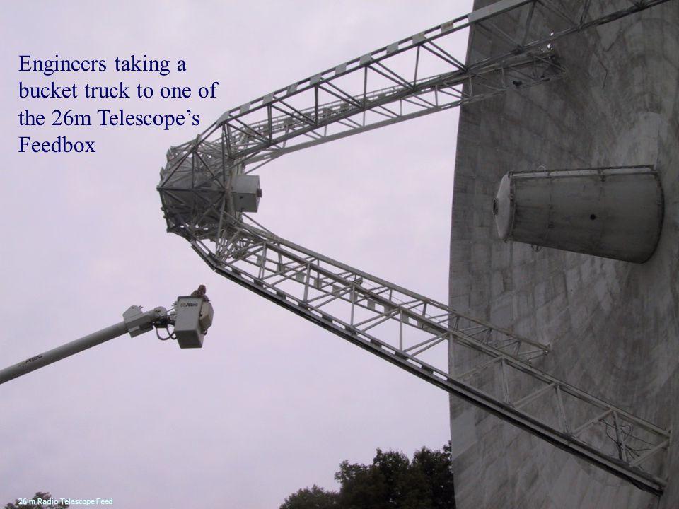 Engineers taking a bucket truck to one of the 26m Telescope's Feedbox 26 m Radio Telescope Feed