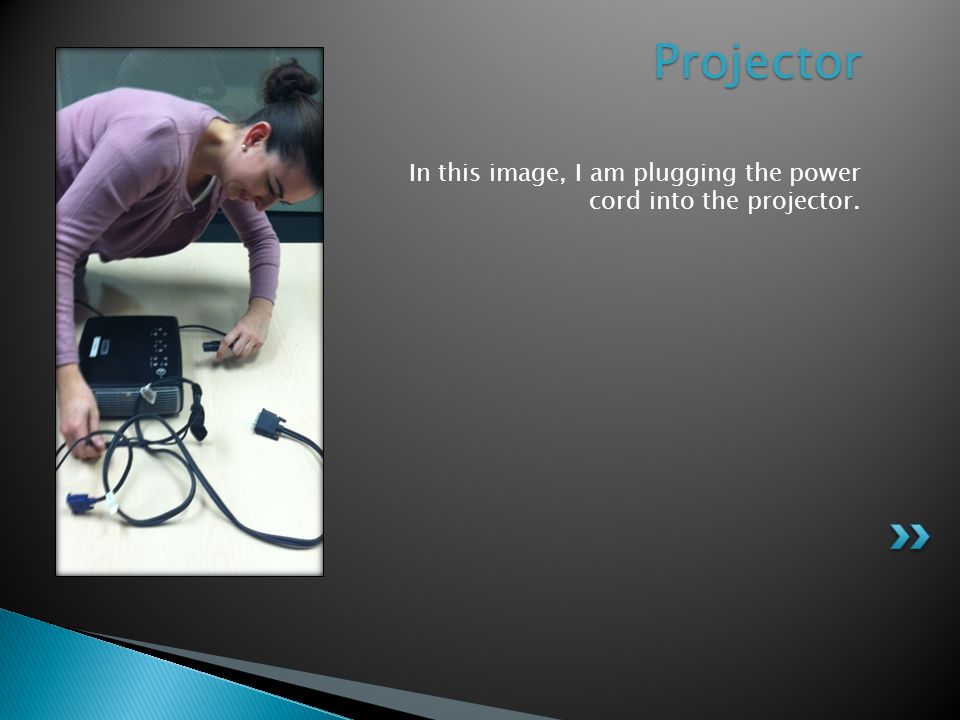 In this image, I am fastening the VGA cable into the projector. VGA Cable