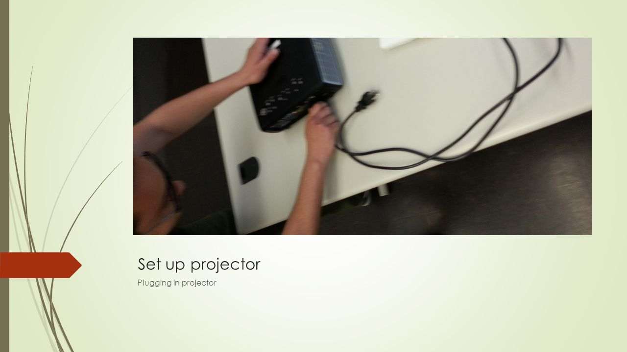 Projector power Plugging in projector power supply wire