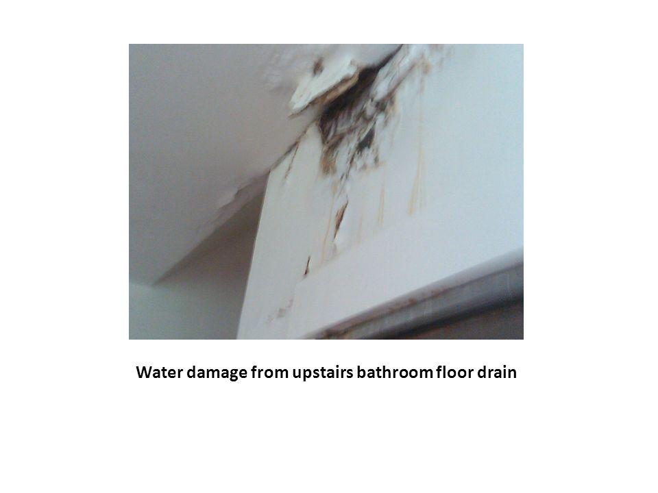 Water damage from upstairs bathroom floor drain