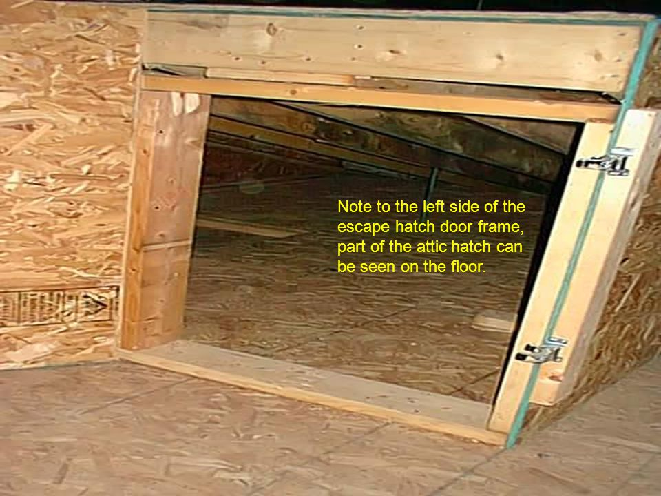 Note to the left side of the escape hatch door frame, part of the attic hatch can be seen on the floor.