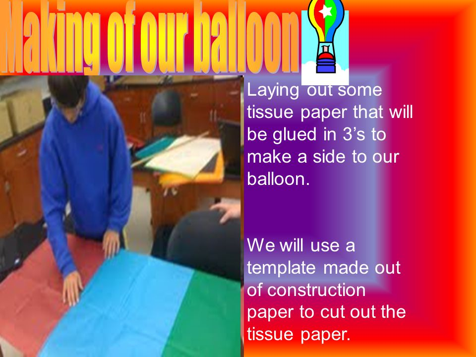 Laying out some tissue paper that will be glued in 3's to make a side to our balloon.