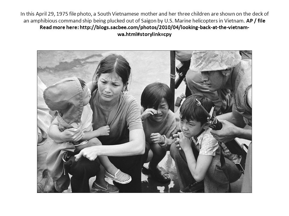 In this April 29, 1975 file photo, a South Vietnamese mother and her three children are shown on the deck of an amphibious command ship being plucked out of Saigon by U.S.