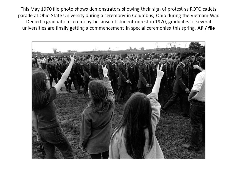 This May 1970 file photo shows demonstrators showing their sign of protest as ROTC cadets parade at Ohio State University during a ceremony in Columbus, Ohio during the Vietnam War.