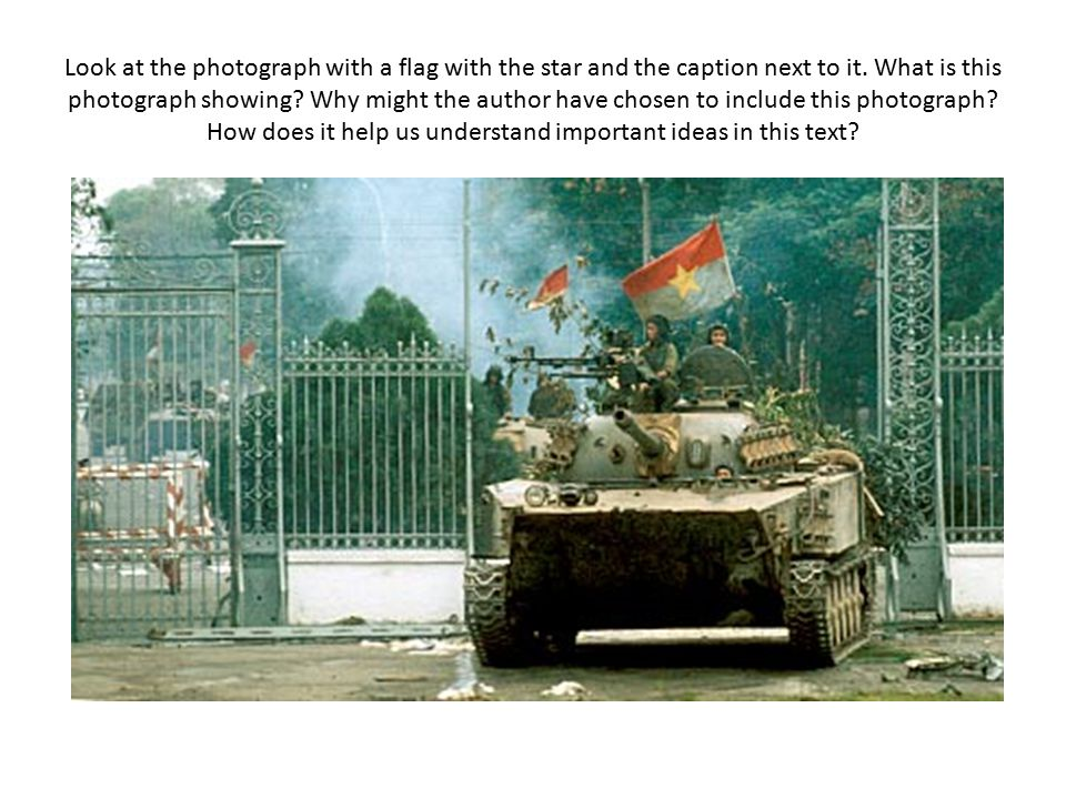 Look at the photograph with a flag with the star and the caption next to it.