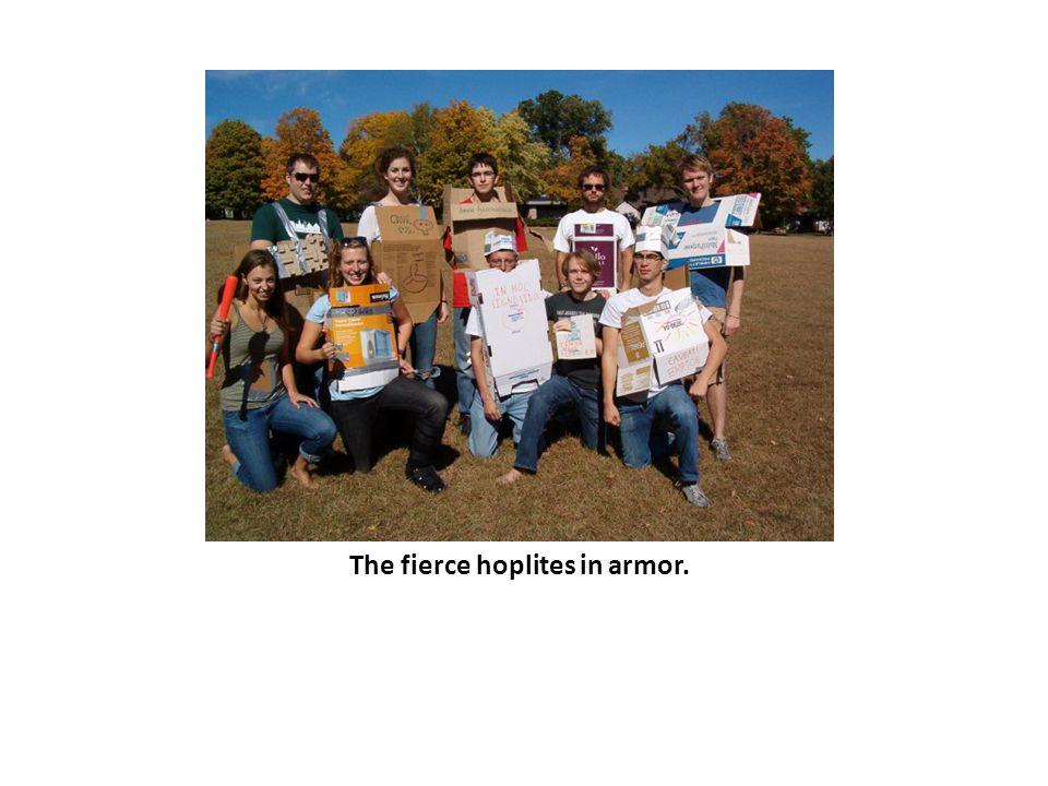 The fierce hoplites in armor.
