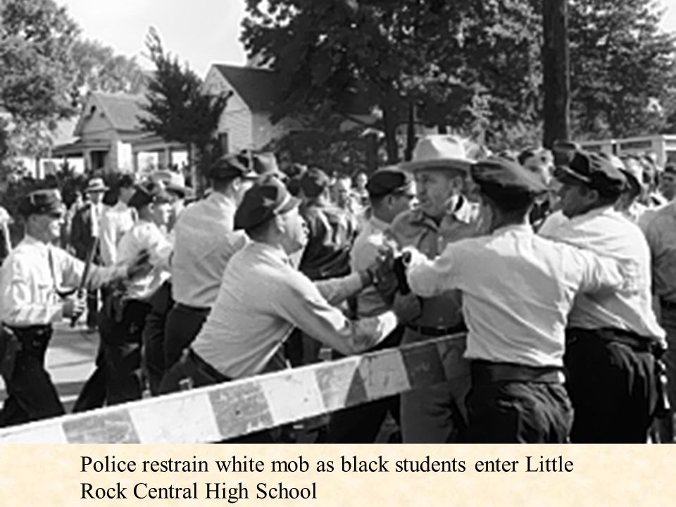 Police restrain white mob as black students enter Little Rock Central High School