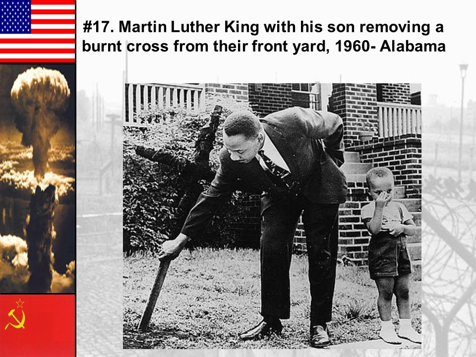#17. Martin Luther King with his son removing a burnt cross from their front yard, 1960- Alabama