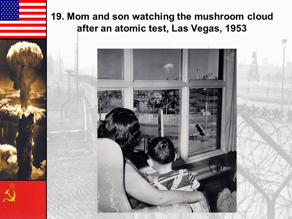 19. Mom and son watching the mushroom cloud after an atomic test, Las Vegas, 1953