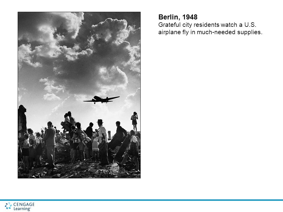 Berlin, 1948 Grateful city residents watch a U.S. airplane fly in much-needed supplies.