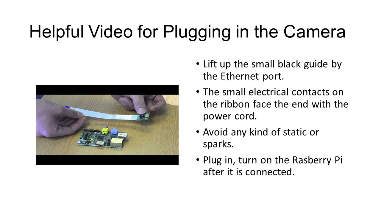 Helpful Video for Plugging in the Camera Lift up the small black guide by the Ethernet port.