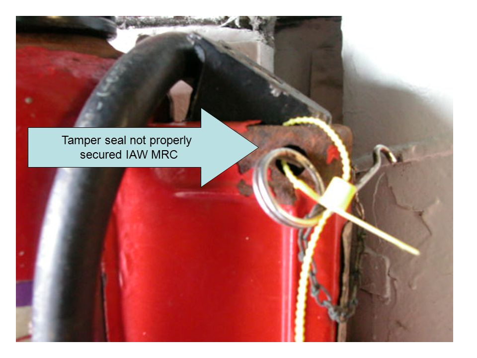 Tamper seal not properly secured IAW MRC