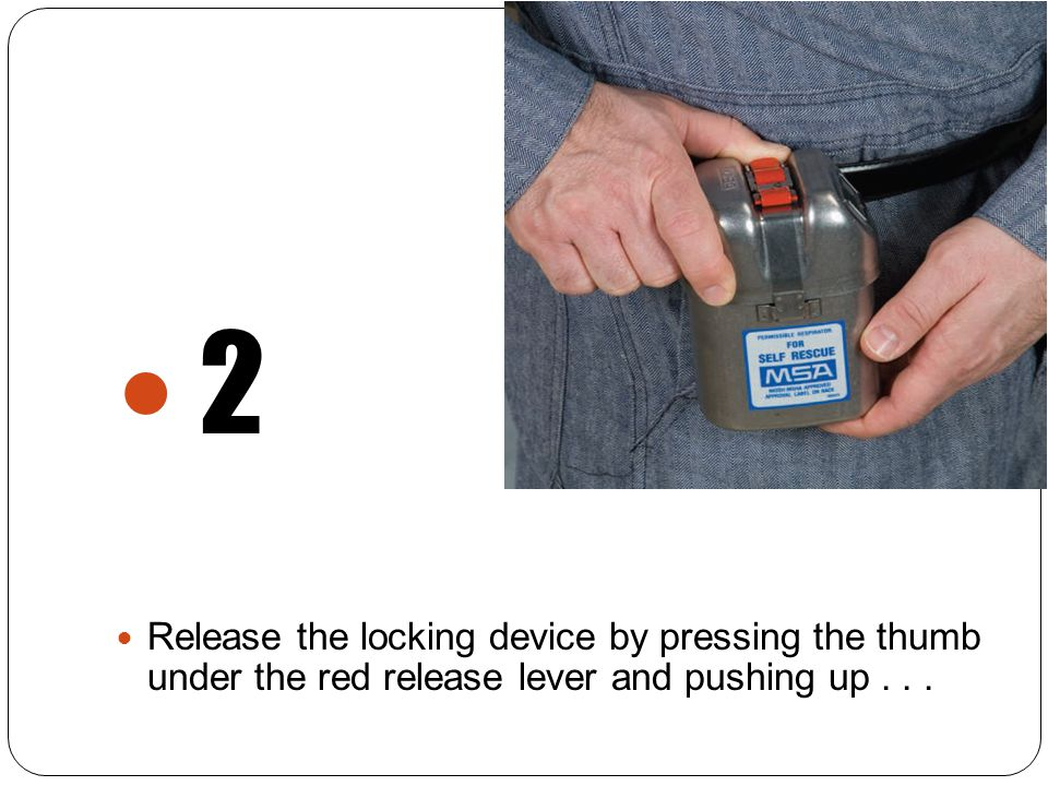 2 Release the locking device by pressing the thumb under the red release lever and pushing up...